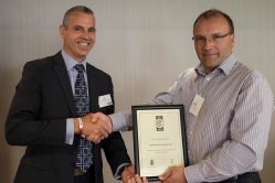 Roy Adair - Open Network Associates - being presented with his DERS Bronze Award by Jon Beake - Wessex RFCA